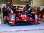 NR.13, Rebellion Racing, Rebellion R-One (AER) LMP1 für die Fahrer: Mathéo Tuscher, Alexandre Imperatori, Dominik Kraihamer.Noch in der Box wärend des offiziellen Pit Walk wärend